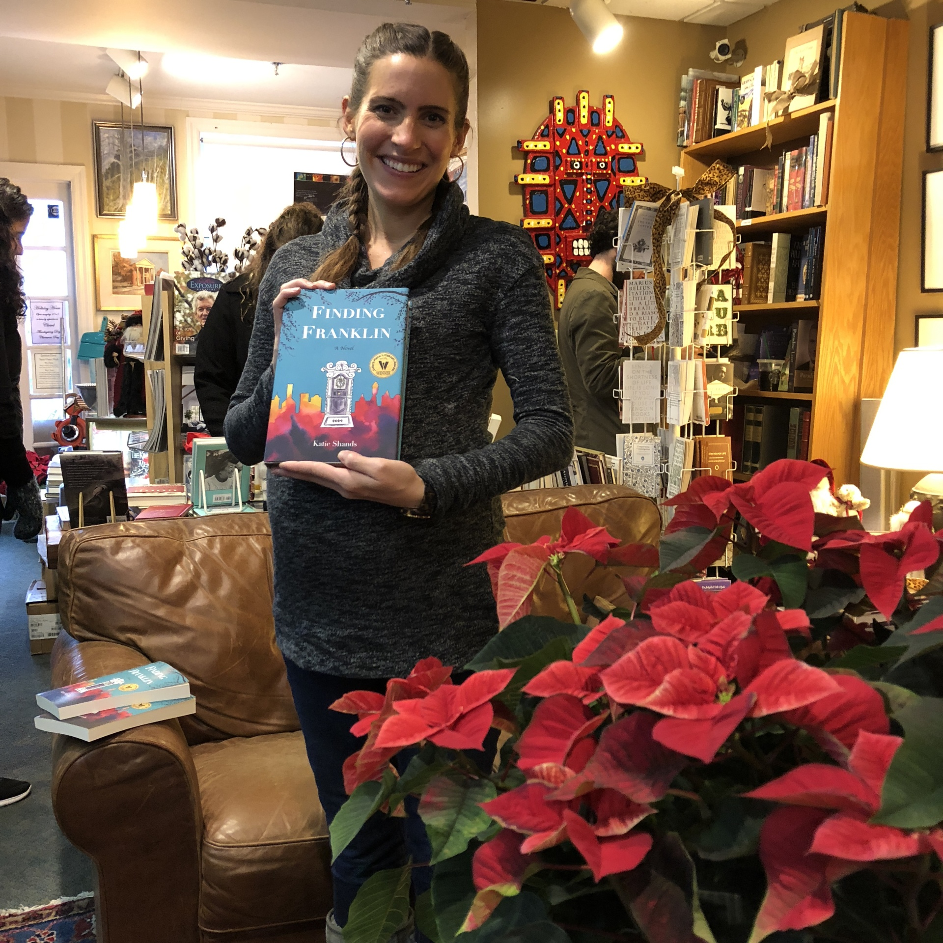 "Katie Shands sells copies of ""Finding Franklin"" at Landbook Booksellers during Dickens of a Christmas."